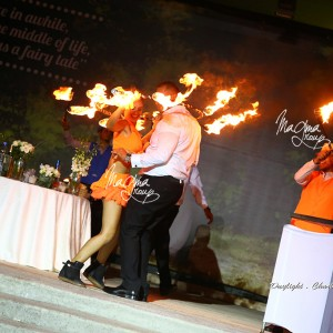 magma-group-fire-hoop-with-bride-groom-show-cake