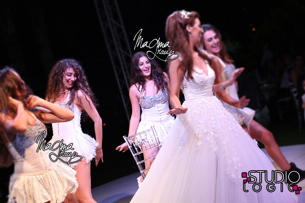 magma-group-bride-dance-cake-wedding